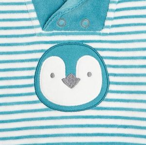 Striped velvet footed sleeper with a penguin motif